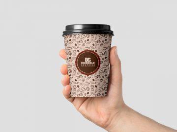 Hand Holding Coffee Cup - Free PSD Mockup
