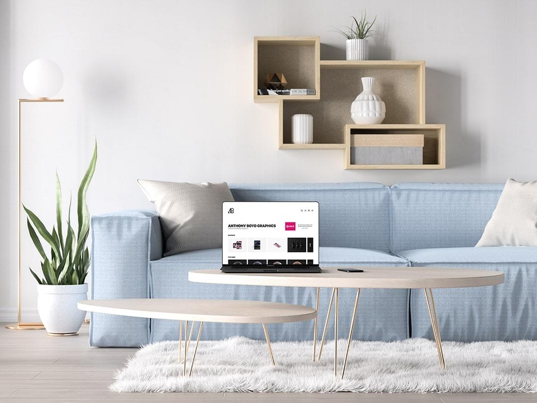 Free Bezel-Less MacBook Pro in Living Room Mockup.