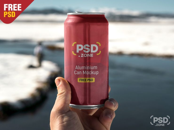 Free Hand Holding Aluminum Can Mockup PSD.