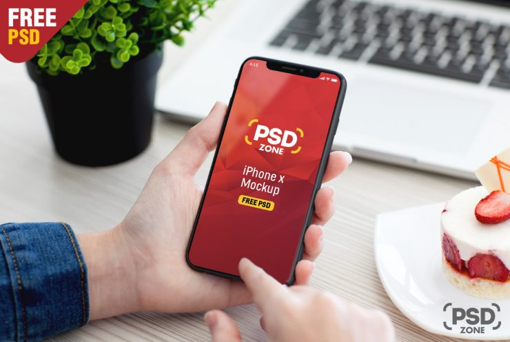 Free Male Hand Holding iPhone X Mockup PSD.