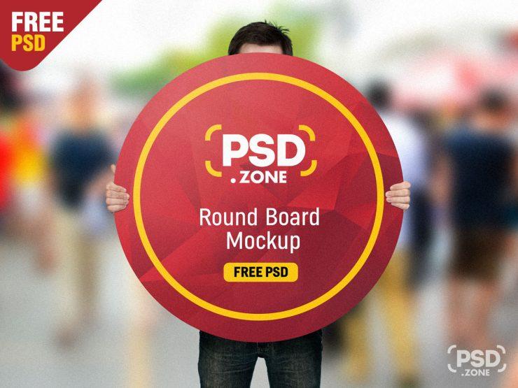 Man Holding Round Board Free Mockup