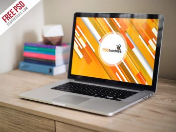Macbook Pro on Wooden Table - Free Mockup