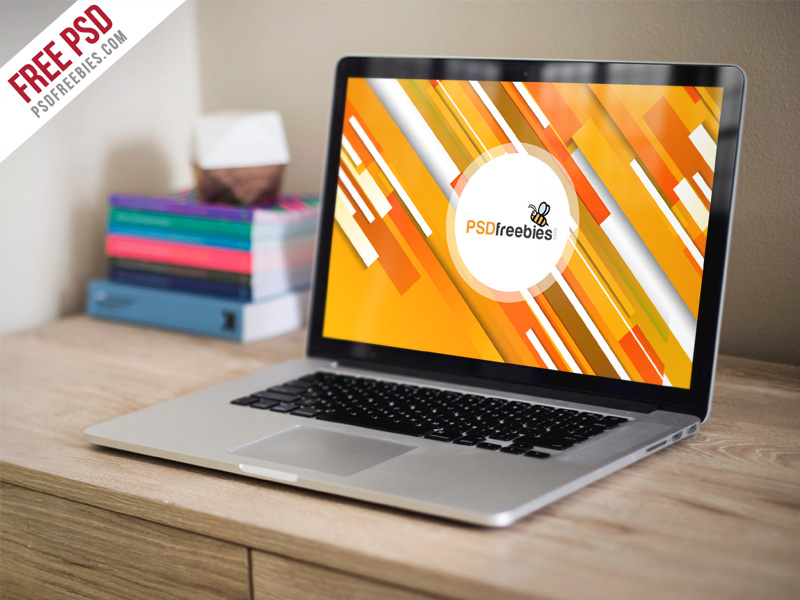 Macbook Pro on Wooden Table Free Mockup