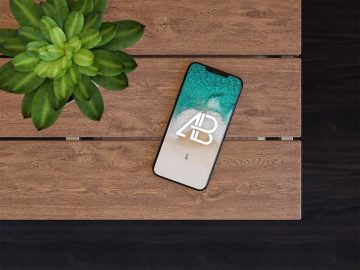 iPhone X On Table - Free Mockup