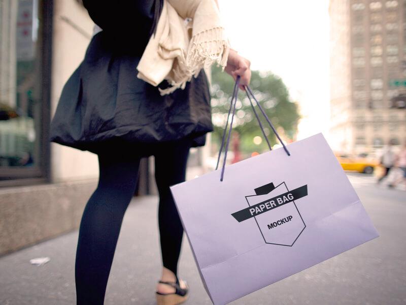 Girl Holding Paper Bag - Free Mockup