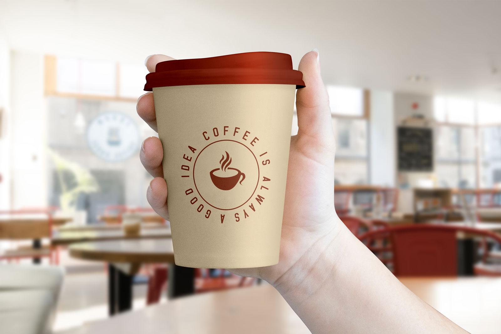 Free Hand Holding Coffee Cup Mockup