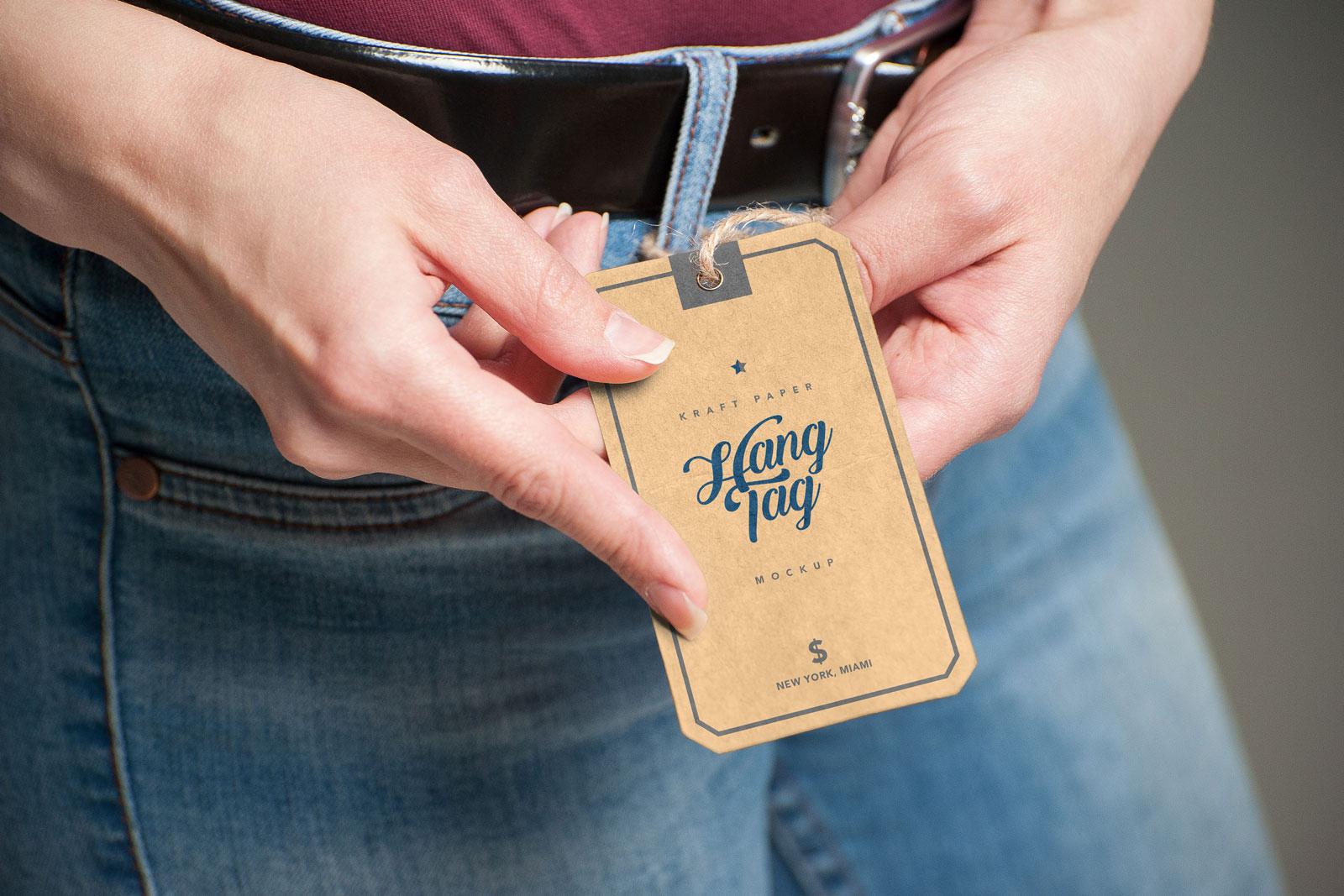 Free Hand Holding Kraft Paper Hang Tag Mockup