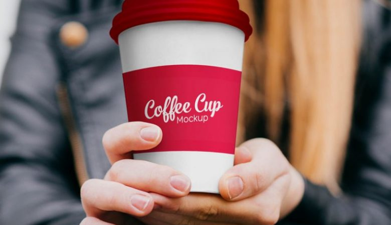 Free Paper Coffee Cup in Hand Mockup