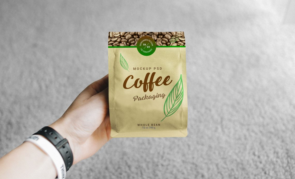 Free Hand Holding Coffee Bag Packaging Mockup